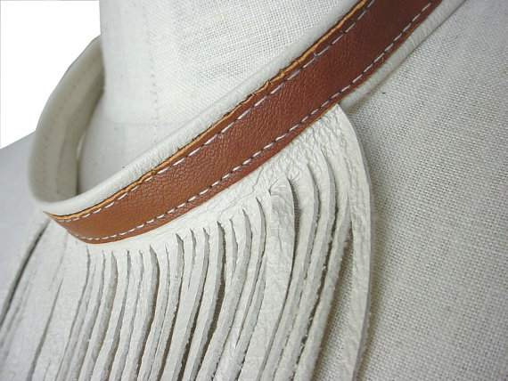 It could be the summer heat, but I'm ready to put on my cowboy boots and make something with fringe...maybe as beautiful as this fringe necklace by ManoBello.